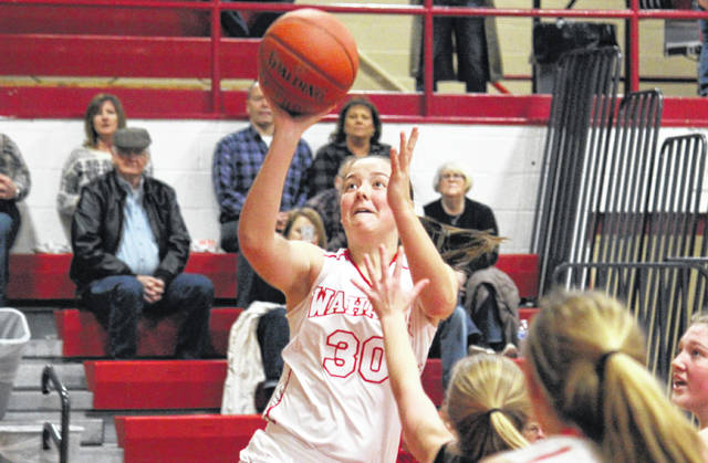Wahama sophomore Lauren Noble (30) glides in for a layup, during the Lady Falcons' 49-34 victory in the Class A Region 4, Section 1 tournament opener on Friday in Mason, W.Va.