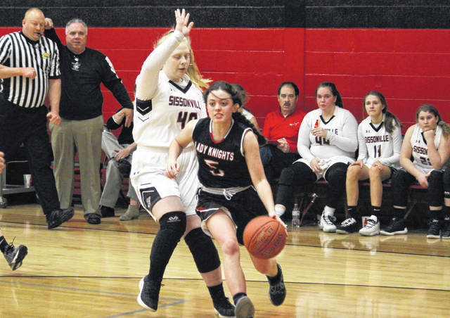 Point Pleasant senior Morgan Miller (5) drives to the basket in front of Sissonville sophomore Madalynn Asbury (40), during the Lady Indians' 64-40 victory in Monday's Class AA Region IV, Section 1 quarterfinal in Sissonville, W.Va.