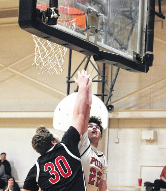 PPHS senior Nick Smith shoots a two-pointer over a Wayne defender, during the Big Blacks' 40-point victory on Feb. 18 in Point Pleasant, W.Va.
