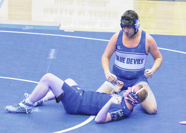 Gallia Academy freshman Chris Moore rises up from an opponent after scoring a pinfall victory during a Dec. 18, 2019, dual match against Warren at GAHS in Centenary, Ohio. (Bryan Walters|OVP Sports)