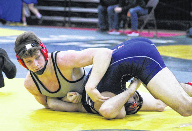 Point Pleasant senior Logan Southall pins an opponent during a 170-pound Class AA-A opening round match Thursday night at Mountain Health Arena in Huntington, W.Va.