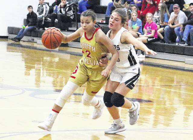 South Gallia senior Amaya Howell (2) tries to dribble around River Valley defender Lauren Twyman during the first half of a Jan. 6 girls basketball game in Bidwell, Ohio.
