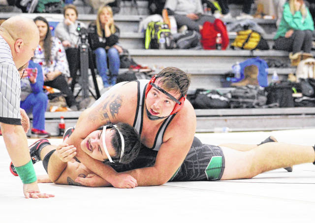 Point Pleasant senior Jacob Muncy maintains leverage on an opponent during a heavyweight match against Winfield on Dec. 11, 2019, in Point Pleasant, W.Va.