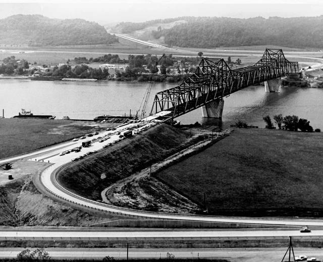 Pictured is an undated photo showing the decking being placed on the Silver Memorial Bridge which was completed in 1969 and still stands, connecting Mason and Gallia counties. Also pictured is U.S. 35 and the shoreline of Gallia County on the horizon.