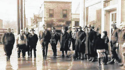 Area residents stand at the corner of Second Avenue and Court Street during the 1937 Flood.