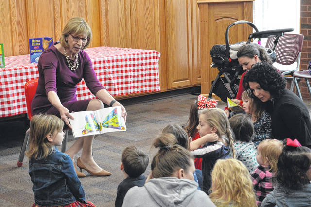 Ohio First Lady Fran DeWine reads to young visitors at the Gallia Bossard Memorial Library on Monday.