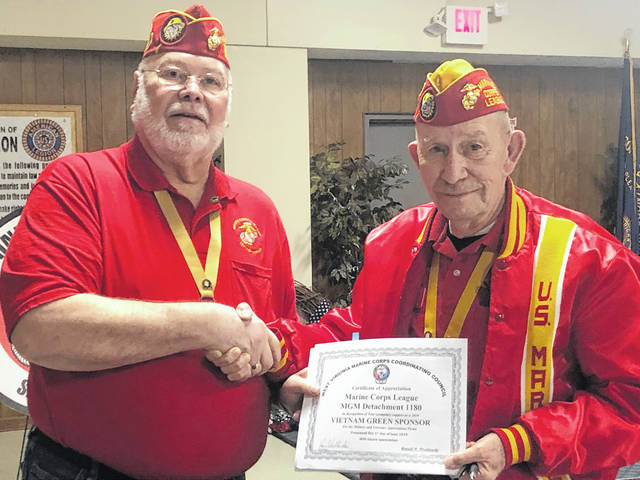 Jim Doss (at right), Commandant of Marine Corps League, Mason-Gallia-Meigs Detachment 1180 was presented a Certificate for a 'Vietnam Green' sponsorship for the Military & Veterans Appreciation Picnic. The certificate was presented by Ron Wroblewski (at left). Ron is the organizer for the event held each spring. This year will be the ninth year for the event and will be held on May 30. At last year's event they served over 1,250 lunches to military, veterans and their guests. The menu: hot dogs, barbecue, grilled chicken, baked beans, potato salad, coleslaw, ice cream, watermelon, drinks and much more. All free to military, veterans and their guests. For more information, contact Ron Wroblewski at (740) 446-1795.