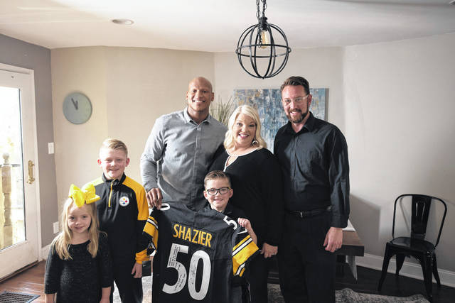 """Brandy Sweeney and her family, including husband Brandon and children Braydon, Bryson and Braylon, recently spent time with Ryan Shazier of the Pittsburgh Steelers, pictured back row at left. Brandy was chosen as one of Shazier's """"50 Phenoms."""" (UPMC 