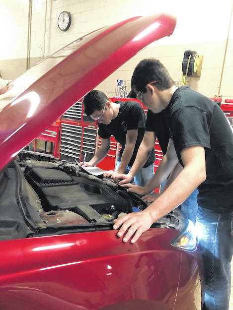 Buckeye Hills auto service students inspect a vehicle.