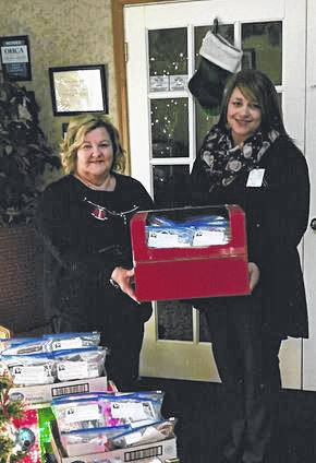 Gail Belville, left, president of the Gallia County Retired Teachers Association, presents gift bags on behalf of the organization to Carla Crawford, activities coordinator at Holzer Assisted living of Gallipolis. The gift bags were distributed to the residents of the facility.