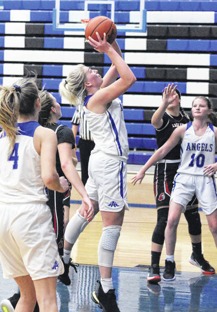 Gallia Academy junior Maddy Petro, middle, releases a shot attempt during a Jan. 2 girls basketball contest against Point Pleasant in Centenary, Ohio.