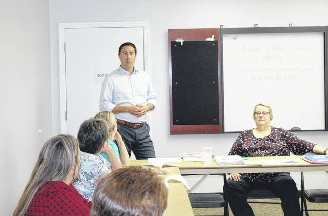 Ohio Secretary of State Frank LaRose spoke with poll workers and Board of Elections officials during a visit to Meigs County last fall.