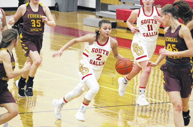 South Gallia senior Amaya Howell (2) leads a fast break, during the Lady Rebels win over Federal Hocking on Jan. 13 in Mercerville, Ohio.