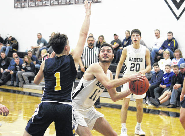 River Valley senior Brandon Call (11) works in the low post in front of teammate Jordan Lambert (20), during a Dec. 17 bout with Wellston in Bidwell, Ohio.