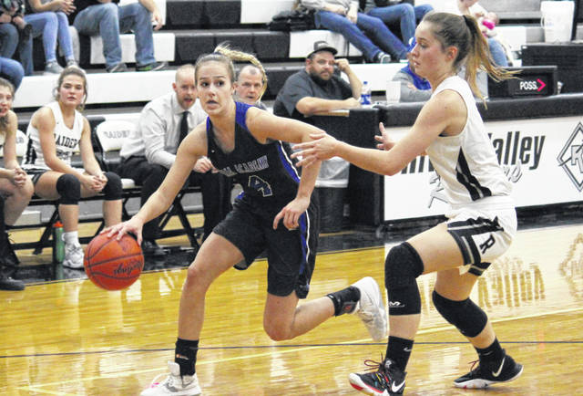 Gallia Academy Alex Barnes (4) drives past River Valley junior Hannah Jacks (right), during a non-conference game on Nov. 25 in Bidwell, Ohio.