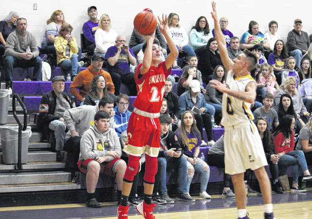 South Gallia sophomore Brayden Hammond (20) tries a three-point shot over Southern senior Cole Steele (0), during a TVC Hocking game on Jan. 17 in Racine, Ohio.