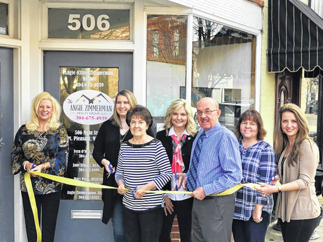 """The Angie Zimmerman Realty Group recently celebrated its official business ribbon cutting on Main Street with staff and City of Point Pleasant officials. Angie (Cline) Zimmerman, Broker/Owner/Realtor, said the office officially opened in September 2019, adding, """"I found need for full service brokerage in the area."""" Located at 506 Main Street, the group offers three full-time Realtors and support staff in the areas of buying/selling/property management. Zimmerman is a retired NICU RN, born and raised in West Virginia but lived in Phoenix, Ariz. for 20 years, before becoming a full-time Realtor. """"Part of our mission statement is to give back to our community each year,"""" Zimmerman said. Celebrating in the ribbon cutting were, from left, Zimmerman, Jade Schultz, Realtor, Fern O'Neil, Realtor, Mary Pyles, Realtor, Mayor Brian Billings, Carolyn Koenig, office manager, City Clerk Amber Tatterson. Call 304-675-4939 or find the Angie Zimmerman Realty Group on Facebook for more information."""