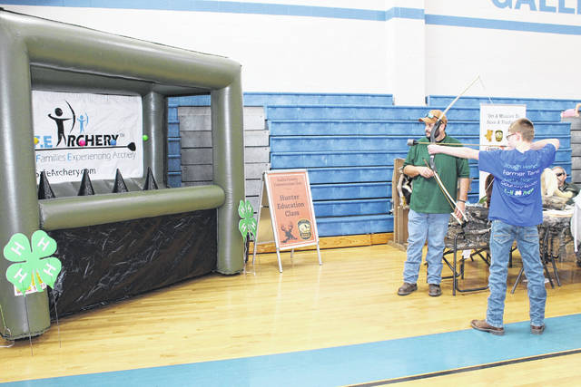 Visitors practice archery during last year's expo.