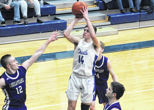 GAHS senior Logan Blouir (14) tries a jump shot in between three Panthers, during the Blue Devils' 17-point setback on Feb. 12 in Centenary, Ohio.