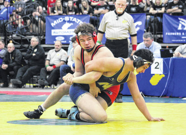 Point Pleasant senior Juan Marquez locks in a hold during the Class AA-A 195-pound championship match on Saturday night at Mountain Health Arena in Huntington, W.Va.