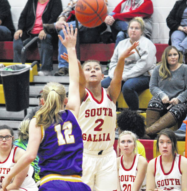 South Gallia senior Amaya Howell (2) shoots a three-pointer over Southern sophomore Kayla Evans (12), during a TVC Hocking bout on Dec. 5 in Mercerville, Ohio.