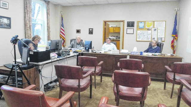 Gallia Commissioners discuss efforts to maintain public meetings amidst the COVID-19 outbreak. A camera at left has been set up to stream commission meetings.