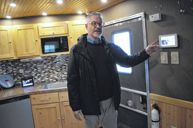 Ross County Board of Developmental Disabilities IT Director George Myers displays the technology of a mobile smart home.