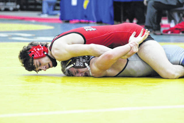 Point Pleasant junior Isaac Short maintains leverage on an opponent during a 120-pound Class AA-A championship match Saturday night at Mountain Health Arena in Huntington, W.Va.