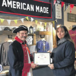 SAR presents Flag Certificate to business