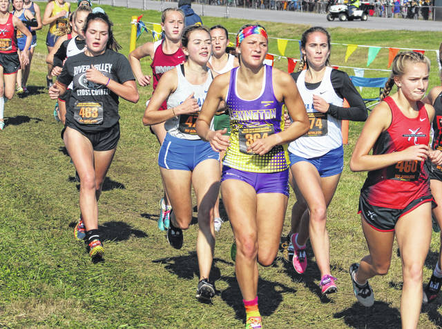 Gallia Academy junior Sarah Watts, second from right, and River Valley sophomore Lauren Twyman (463) both keep pace with a pack of runners during the Division II girls cross country championship race held Saturday, Nov. 6, 2019, at National Trail Raceway in Hebron, Ohio.