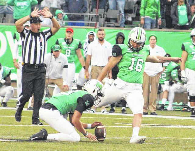 Marshall senior Justin Rohrwasser (16) approaches a game-winning field goal attempt as timeout is called during the fourth quarter of an Oct. 26, 2019, Conference USA football contest against Western Kentucky in Huntington, W.Va.