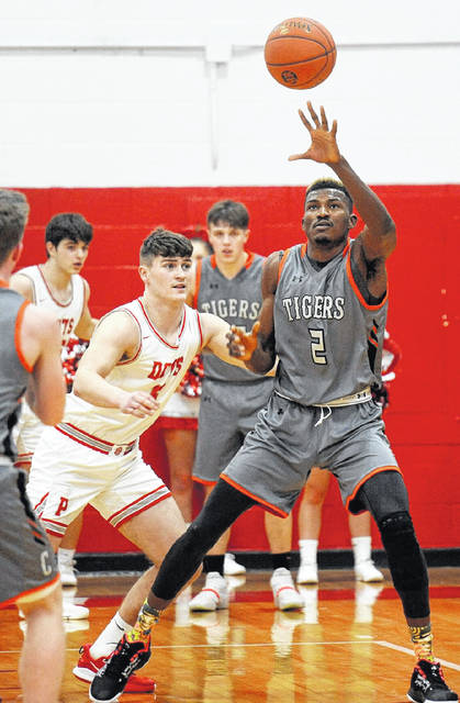 Chapmanville's Obinna Anochili-Killen accepts an entry pass against the defense of Poca's Toby Payne in a game earlier this season. Anochili-Killen was named captain of the Class AA first team all-state team.