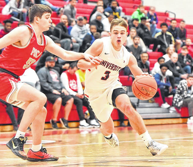 University senior Kaden Metheny (3) dribbles past a Poca defender during a Dec. 14, 2019, boys basketball contest at the Big Shots Country Roads Tip-off Classic held at UHS in Morgantown, W.Va.