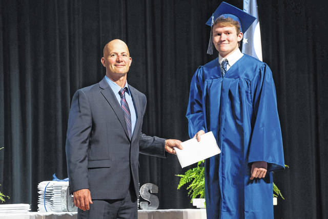 Class of 2020 graduate Evan Bryce Rodgers is pictured receiving his diploma from Superintendent Craig Wright. Rodgers will be joining the US Marine Corps. (Bartee Photography | Courtesy)