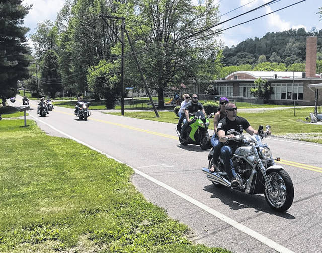The 35th annual Meigs Memorial Run and related events were officially canceled last weekend, but that did not stop several dozen motorcycles, riders and other vehicles, from taking part in the event. Participants made their way through Pomeroy, Middleport, Rutland, and more, riding the traditional route, enjoying Sunday's warm, sunny weather conditions. Several to the participants are pictured here on Bradbury Road.