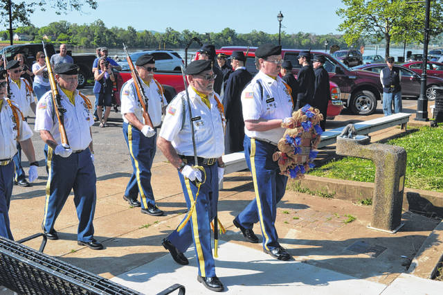 The VFW 4464 Honor Guard marches towards the Gallipolis City Park Spirit of the American Dough Boy with a wreath in honor of America's fallen veterans.
