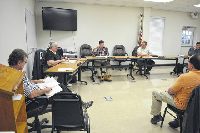 The Gallipolis City Commission practices social distancing at the last in-person commission meeting in March.