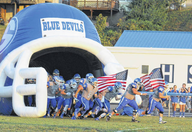 Members of the Gallia Academy football team take the field during a football contest against Chesapeake at Memorial Field on Sept. 20, 2019, in Gallipolis, Ohio.