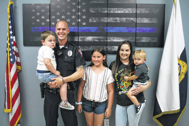 Gallipolis Police Officer of the Year Shane Plantz stands with his wife Jenna Plantz and their children.