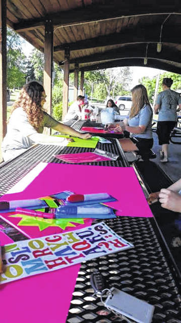 Gallia youth create signs to be hung at the opening of the Gallipolis Municipal Swimming Pool. (Sharla Moody | Courtesy)