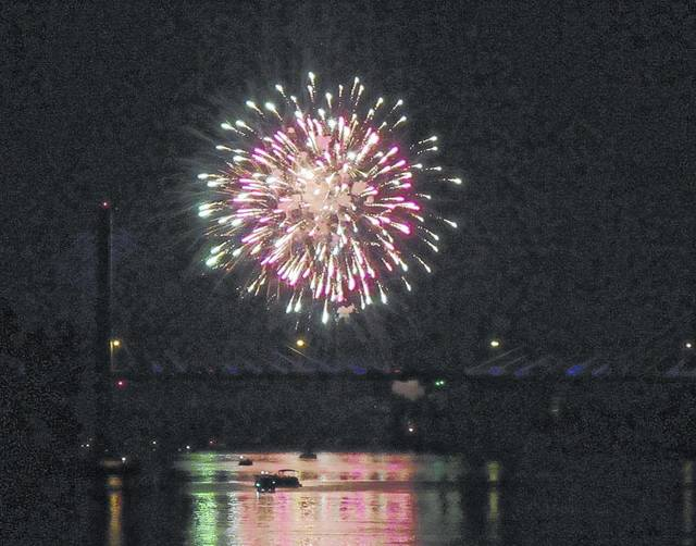 Fireworks light up the sky above the Bridge of Honor.