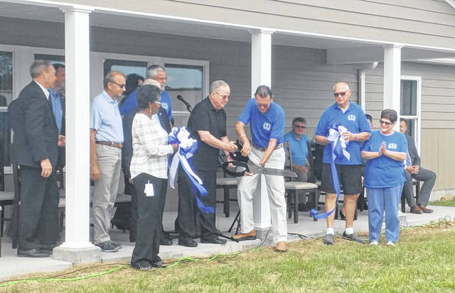Field of Hope supporters and staff cut a ribbon in celebration of the opening of Field of Hope's Faith House in August of last year. (OVP File Photo)