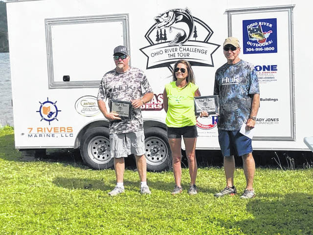 Taking First Place, with 9.36-pounds, Buster Owens and Rick Lanham. Also pictured, Amanda Crouse, executive director of the Gallia County Convention and Visitors Bureau. (GCCVB | Courtesy)