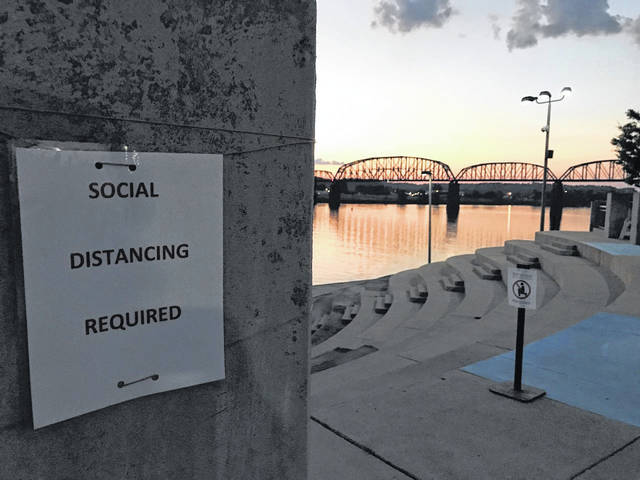Pictured is the sun setting on Riverfront Park in Point Pleasant where many outdoor events take place. On Monday, Gov. Jim Justice ordered a 25-person limitation on social gatherings. (Beth Sergent | OVP)
