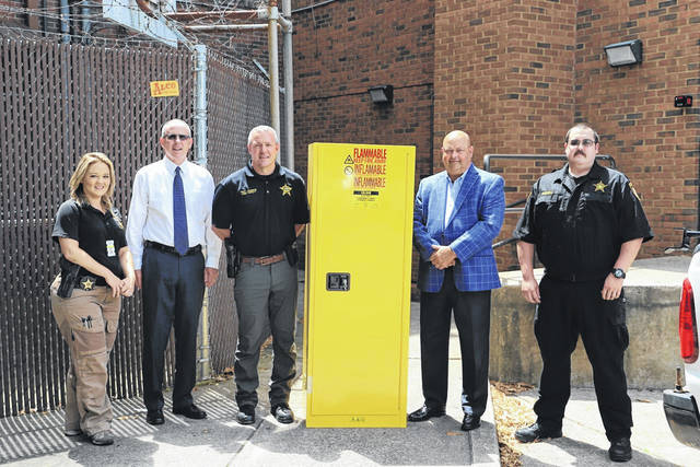 Ohio Valley Bank recently helped out the Gallia County Sheriff's Office with a donation to purchase a locking flammables storage cabinet needed by the sheriff's office for safety. Pictured from left, Deputy Elizabeth Barger, OVB President and COO Larry Miller, Chief Troy Johnson, OVB Chairman and CEO Tom Wiseman, and Corrections Officer Michael Russell. (OVB | Courtesy)