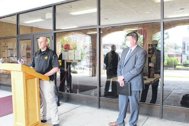 Gallia Sheriff Matt Champlin, at the podium, and Gallia Prosecutor Jason Holdren, update the media on Friday regarding the reported shooting incident involving an infant victim in Ohio Township. (Beth Sergent | OVP)