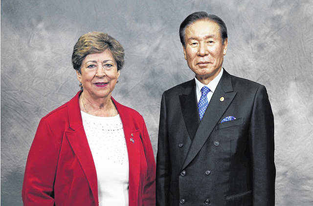 Ollie Paxton-Tipple of Gallipolis, at left, has taken the oath of office as the new Lions Club District Governor in an online ceremony with Lions Clubs International President Dr. Jung-Yul Choi of South Korea, also pictured. (Courtesy Photo)