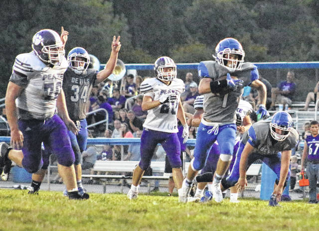 Gallia Academy sophomore Briar Williams (1) breaks away from Chesapeake defenders for a touchdown during the first half of a Friday, Sept. 20, 2019, OVC football contest at Memorial Field in Gallipolis, Ohio.
