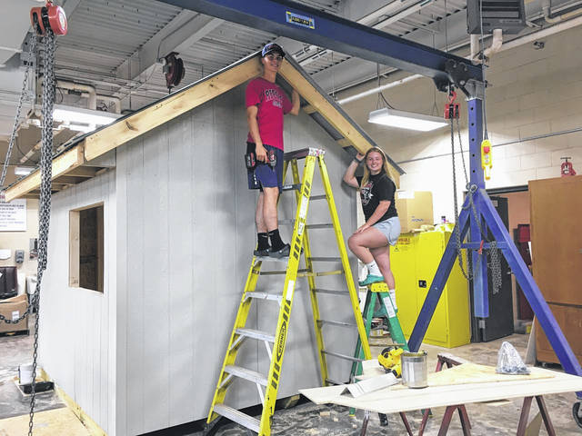 Members of the South Gallia High School FFA program recently built and donated a new Gallia County Fair Entrance Ticket Booth for the 2020 Gallia County Junior Fair. Pictured are South Gallia High School Seniors Andrew Small and Emma Shamblin. Fair week will run from Monday, Aug. 3 - Saturday, Aug. 8. The schedule is reduced from typical years, but does include more activities and events than junior fair shows. The South Gallia FFA Advisor is David Pope. (SGHS | Courtesy)
