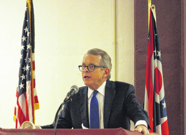Governor Mike DeWine speaks during the Meigs County Republican Party Lincoln Day Dinner in February at Meigs High School. (OVP File Photo)